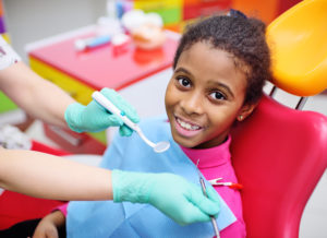 African American girl visiting the dentist